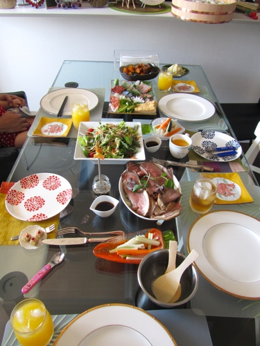 The set-up for DIY temaki (hand-rolled) sushi - sushi rice nori and loads of fresh seafood & Saying